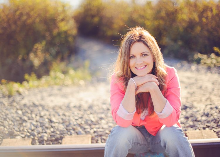 Kelita, Coral, Woman sitting on train tracks